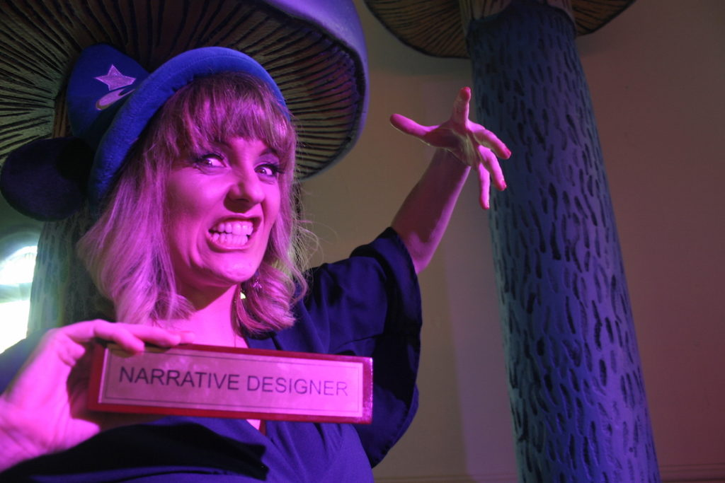 Photo of Christy bearing teeth with narrative designer name plate