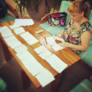 Christy at a table with a lot of index cards